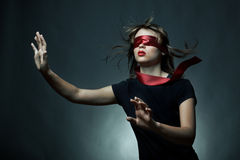 Portrait of the young woman blindfold stock photos