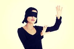 Portrait of the young woman blindfold Royalty Free Stock Photo