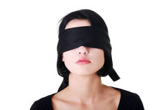Portrait of the young woman blindfold Royalty Free Stock Photos