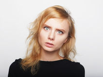 Portrait of a young woman with blond hair in a black shirt on a. White background. A woman without makeup. Model test. Fashion model Royalty Free Stock Photography