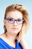 Portrait of Young Woman with Blond Hair and glasses Royalty Free Stock Photography