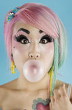 Portrait of young woman blowing bubble gum Royalty Free Stock Photography