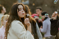 Portrait of young woman blowing soap bubbles on a flashmob in Volgograd Stock Photography