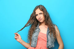 Young woman. Portrait of young woman on blue background royalty free stock photos