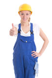 Portrait of young woman in blue builder uniform thumbs up isolat Royalty Free Stock Images