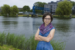 Portrait of young woman in blue dress against a dutch canal Royalty Free Stock Photos