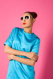 Portrait on young woman in blue dress and white sunglasses Royalty Free Stock Photos