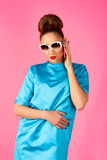 Portrait on young woman in blue dress and white sunglasses Royalty Free Stock Photo