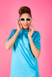 Portrait on young woman in blue dress and white sunglasses Royalty Free Stock Photography