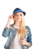 Portrait of young woman in blue hat Royalty Free Stock Photography