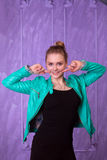 Portrait of a young woman in blue jacket Royalty Free Stock Photos