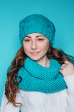 Portrait of a young woman in a blue knitted hat Royalty Free Stock Images