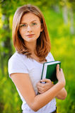 Portrait of young woman with book Royalty Free Stock Image