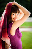Portrait of young woman with bordeaux shawl Stock Photography