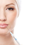 Portrait of a young woman on a botox injection Stock Photo
