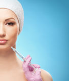 Portrait of a young woman on a botox injection procedure Royalty Free Stock Images