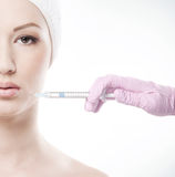 Portrait of a young woman on a botox injection procedure Royalty Free Stock Photos