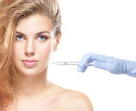 Portrait of a young woman on a botox injection procedure Royalty Free Stock Photography