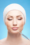 Portrait of a young woman on a botox procedure Royalty Free Stock Images