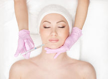 Portrait of a young woman on a botox procedure Stock Photography