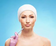 Portrait of a young woman on a botox procedure Stock Photos