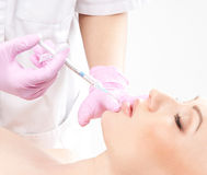 Portrait of a young woman on a botox procedure Royalty Free Stock Photo