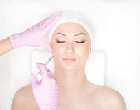 Portrait of a young woman on a botox procedure Stock Photo