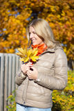 Portrait of young woman with bouquet of maple leaves. Portrait of young beautiful woman with bouquet of maple leaves stock photos
