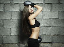 Portrait of young woman boxing Stock Images
