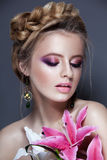 Portrait of young woman with braid hair and flowers in hand Stock Images