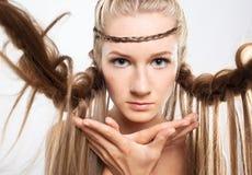 Portrait of young woman with braid hairdo. Portrait of beautiful young woman with creative braid hairdo Royalty Free Stock Photos