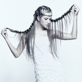 Portrait of young woman with braid hairdo Royalty Free Stock Image