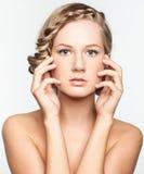 Portrait of young woman with braid hairdo. Portrait of beautiful young woman with creative braid hairdo Stock Photos
