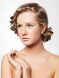 Portrait of young woman with braid hairdo royalty free stock photo