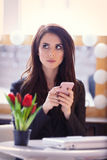 Portrait of young woman with bunch of tulips, laptop and mobile Stock Photos