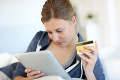 Portrait of young woman buying on internet Royalty Free Stock Image