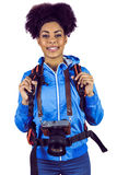 Portrait of a young woman with camera and backpack Royalty Free Stock Images