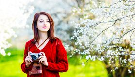 Portrait of young woman with camera royalty free stock image