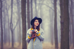 Portrait of a young woman with a camera Stock Photography