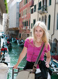 Portrait of the young woman on Canal backgraund. Venice, Italy Stock Image