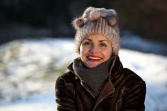 Portrait of a young woman with a cap. Beautiful young woman in a park in winter time Royalty Free Stock Images