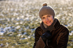 Portrait of a young woman with a cap. Beautiful young woman in a park in winter time stock image