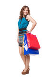 Portrait of young woman carrying shopping bags Royalty Free Stock Images