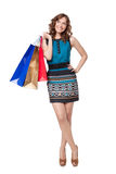 Portrait of young woman carrying shopping bags Royalty Free Stock Image