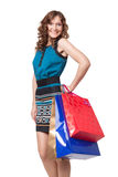Portrait of young woman carrying shopping bags Stock Photos