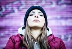 Portrait of a young woman with casual clothes. And a determined look towards the camera in a urban setting Stock Photo