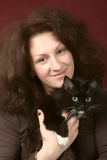 Portrait of the young woman with a cat. Royalty Free Stock Image