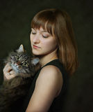 Portrait of young woman with cat Stock Image