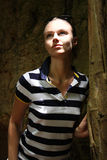 Portrait of the young woman in a cave Stock Photography
