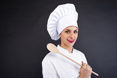 Portrait of young woman chef with spoon Stock Photos